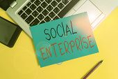 Writing Note Showing Social Enterprise. Business Photo Showcasing Commercial Organization That Has S poster