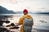 Man Traveler Wearing Yellow Jacket With Backpack Explore Scandinavia Nature. Wanderlust Outdoor Life poster