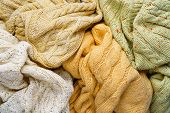 Pile Of Knitted Winter Sweaters. Piles Of Clothes Background poster