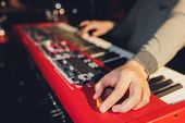 Musician Playing On The Keyboard Synthesizer Piano Keys. Musician Plays A Musical Instrument On The  poster