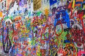 PRAGUE, CZECH REPUBLIC - MAY 26: The Lennon Wall is covered with John Lennon-inspired graffiti and l