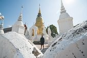 A Man Tourist Is Visiting And Sightseeing At Wat Suan Dok In Chiangmai, Thailand. poster