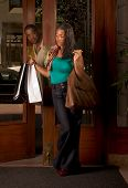 Black Woman With Shopping Bags Man Looking At Her