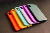 Yellow, Red, Purple, Lilac, Green, Mint Cases For The Smartphone On The Black Background. Protective poster