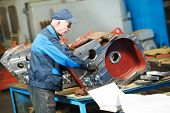adult experienced industrial worker during heavy industry machinery assembling on production line ma