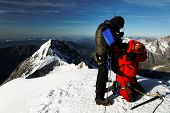 Team of alpinists on Monch Peak  (4107m), Berner Oberland, Switzerland - UNESCO Heritage
