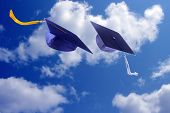 pic of graduation cap  - Two graduation caps flying on beautiful sky - JPG