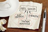 think positive , exercise, eat better - concept of feeling good - sketch on cocktail napkin with cof