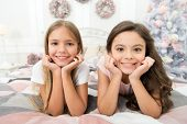 Happiness Lives Here. Happy Children Smile On Bed. Small Girls Enjoy Happiness On Xmas Eve. Childhoo poster