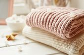 Christmas Background From Knitted Things. Winter Concept. A Stack Of Cozy Knitted Sweaters, Scarves. poster