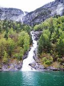 Norwegian Geiranger Fjord With Beautiful Water. Beautiful Fjord Landscape With High Waterfalls To Th poster