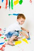 Child Painting The Floors And Walls