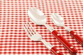 Spoon, fork and knife table setting