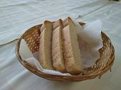 Sliced Delicious Slices Of Fresh Delicious Bread Pastries In A Basket On The Table poster