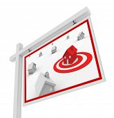 A house in a red target bulls-eye on a for sale sign symbolizing the search for the right real estat