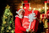 Santa Claus Man Holds Christmas Gift Box. Christmas, Winter, Happiness, Presents. New Year Holidays. poster