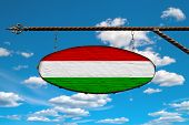 Hungary Flag On A Signboard. Oval Signboard Colors Hungary Flag Hanging On A Metal Forged Structure. poster