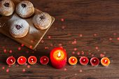 Menorah With Candles (traditional Candelabra) And Traditional Donuts Sufganiyot On Wooden Table For poster
