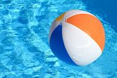 Summer background. Beach Ball on the swimming Pool