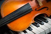 stock photo of violin  - Violin and piano keyboard closeup part  music background - JPG