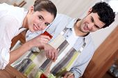 stock photo of concubine  - Man preparing a meal for his girlfriend - JPG