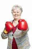 Senior Woman Wearing Boxing Gloves Smiling