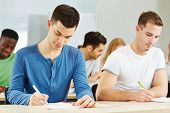 Many students sitting in university class lecture and learning