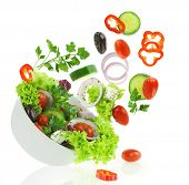 image of edible  - Fresh mixed vegetables falling into a bowl of salad - JPG