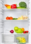 open fridge with fresh vegetables