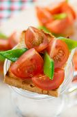 Bruschetta with fresh tomato and snow peas