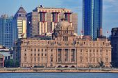 Shanghai historic and urban buildings over Huangpu River in the morning with blue sky.