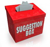 A red Sugestion Box with notes of paper stuffed into its slot offering feedback, comments and constr