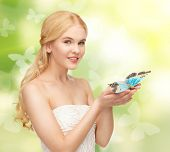 picture of beautiful woman with butterfly in hand