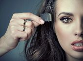 stock photo of insert  - woman inserting card into her head - JPG