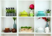 foto of armoire  - Beautiful white shelves with tableware and decor - JPG