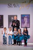 MOSCOW - NOV 4:  Fashion designer with children on charitable show My dream and way to it, in Fashio