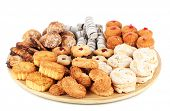 stock photo of dessert plate  - Sweet cookies on wooden plate isolated on white - JPG