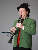 male musician in traditional austrian costume