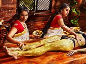 image of panchakarma  - Young woman having feet Ayurveda spa massage - JPG