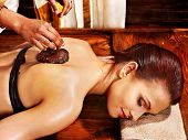 foto of ayurveda  - Young woman having body Ayurveda spa massage - JPG