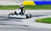 picture of karts  - Teenage racer on a Yamaha engined sprint kart on a road racing circuit - JPG