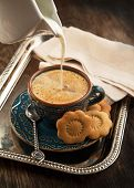 Cup Of Coffee With Milk And Cookies