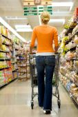 pic of grocery store  - Supermarket Shopper in a orange shirt shopping