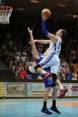 KAPOSVAR, HUNGARY �¢�?�? OCTOBER 26: Jancsikin Branislav (in white) in action at a Hungarian Championship basketball game with Kaposvar (white) vs. Fehervar (blue) on October 26, 2013 in Kaposvar, Hungary.