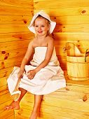 Happy with child relaxing at sauna.