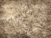 Old Cracked Sheet Of Parchment In Grunge Style  As Background