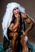 picture of thinkers pose  - Handsome muscular man in a pose of a thinker - JPG