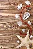 Starfish, Seashells And Stones Brown Wooden Background