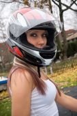 stock photo of wife-beater  - A pretty blonde girl wearing a motorcycle helmet - JPG