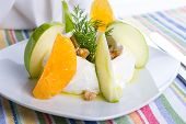 Strained Yogurt Labneh Citrus Salad Garnished With Dill And Walnuts Served With Oil